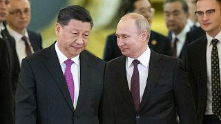 Çin Devlet Başkanı Şi Cinping (sol) Rusya Devlet Başkanı Vladimir Putin