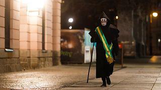 'Grim reaper' artist in Berlin protests Brazil virus stance