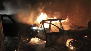 Hijacked cars burn at the peace wall on Lanark Way as rioting broke out in West Belfast, Northern Ireland. April 7, 2021.