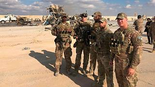 U.S. Soldiers stand at Ain al-Asad air base, Iraq