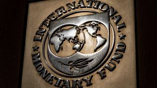 The logo of the International Monetary Fund is visible on their building, Monday, April 5, 2021, in Washington.