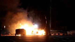 Another night of violence on the streets of Belfast, with people setting fires