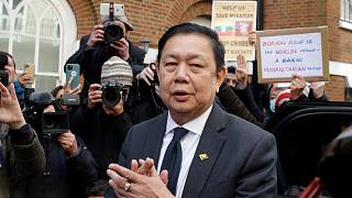 Kyaw Zwar Minn, the Myanmar's ambassador in London stands outside the Myanmar Embassy whilst a statement is read on his behalf in London, Thursday, April 8, 2021.