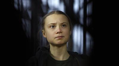 Swedish climate activist Greta Thunberg speaks with the media as she arrives for a meeting of the Environment Council at the European Council building in Brussels, March 2020.