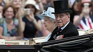 Britain's Queen Elizabeth II and Prince Philip, the Duke of Edinburgh return to Buckingham Palace in a carriage, in London, June 17, 2017.