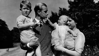 In this August 1951 photo, Princess Elizabeth stands with her husband Prince Philip, the Duke of Edinburgh, and their children Prince Charles and Princess Anne