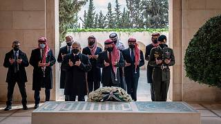 Jordan's King Abdullah II, center, Prince Hamzah bin Al Hussein, second left, and others visit the tomb of the late King Hussein, in Amman Jordan. April 11, 2021.