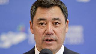 Kyrgyzstan's President Sadyr Japarov speaks to the media at a polling station during the referendum in Bishkek, Kyrgyzstan, Sunday, April 11, 2021. (AP Photo/Vladimir Voronin)