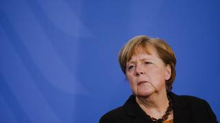 German Chancellor Angela Merkel briefs the media after a virtual meeting with federal state governors at the chancellery in Berlin, Germany, Tuesday, March 30, 2021.