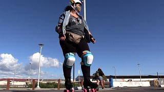 Woman on roller skates and in skating gear