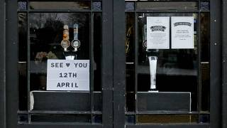 The window of The Rutland Arms pub shows their opening date in Hammersmith, London, Wednesday, April 7, 2021.