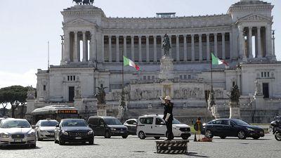 Municipality police man Fabio Grillo directs the traffic standing on a platform in Rome's Piazza Venezia Square.