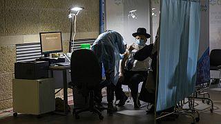 FILE: an ultra-Orthodox Jewish man receives a Pfizer-vaccine in Jerusalem, Jan. 7, 2021.