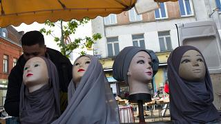 Mannequins present Muslim veils at an open air market in Lille.