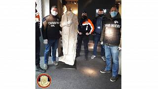 Italian antiquities police the Carabinieri Art Squad with the recovered statue in Brussels
