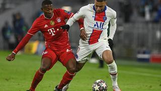 Мбаппе и Алаба борются за мяч в четвертьфинале Лиги чемпионов