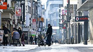 FILE: people walk on the main shopping street in Cologne Germany - Dec. 16, 2020.
