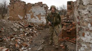 A Ukrainian serviceman patrols near the frontline in the fight against Russian-backed separatists near the small city of Marinka, Donetsk region