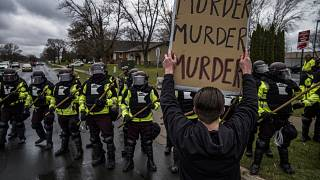 Protesters confronted police over the shooting death of Daunte Wright at a rally at the Brooklyn Center Police Department in Brooklyn Center, Minn., Monday, April 12, 2021.