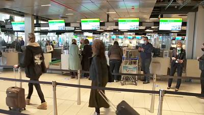 The tourists check in for their flight to Rhodes, Greece at Amsterdam's Schipol Airport on Monday