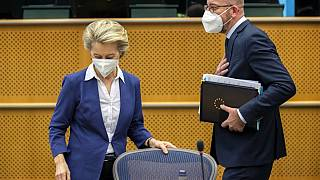 European Commission President Ursula von der Leyen (L) and European Council President Charles Michel arrive for a meeting at the European Parliament