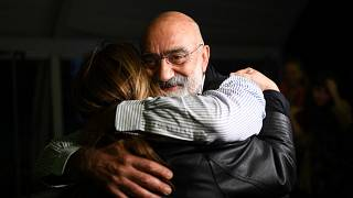 Turkish journalist and writer Ahmet Altan (C) hugs his friends and relatives after being realised briefly on November 4, 2019