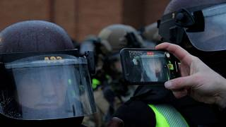 Protestor films state patrol personnel's faces up close with cell phone