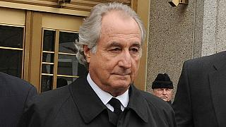 Bernard Madoff exits Manhattan federal court on Tuesday, March 10, 2009, in New York. The disgraced financier has died in a US federal prison.