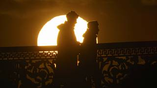 Russian soldiers silhouetted by the setting sun in downtown St. Petersburg, Russia, Friday, March 20, 2020. ((AP Photo/Dmitri Lovetsky)