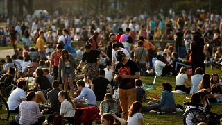 Crowds gathered at Cinquantenaire park during a warm spring day in Brussels on 31 March.