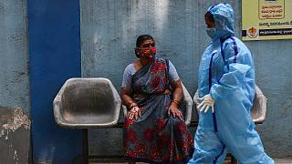 A woman waits to get tested at a COVID-19 testing center in Hyderabad, India, on Wednesday, March 17, 2021. The country is grappling with a rise in COVID-19 infections.