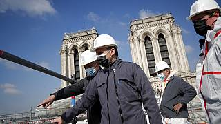 French President Emmanuel Macron visits the reconstruction site of the Notre-Dame cathedral Thursday, April 15, 2021 in Paris