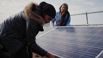 Locals buiding their solar power grid in Brixton, UK