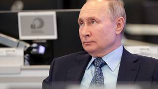 FILE: Russian President Vladimir Putin visits the Coordination Center of the Russian Government in Moscow, Russia, Tuesday, April 13, 2021.