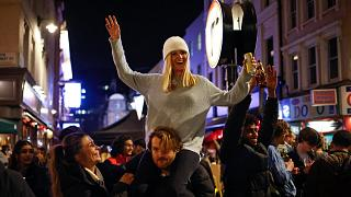 People drink in the street in the Soho area of London as COVID-19 restrictions are eased in step two of the government's roadmap out of England's third national lockdown