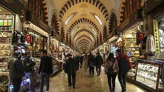 Shoppers browse stalls at Istanbul's Egyptian bazaar.