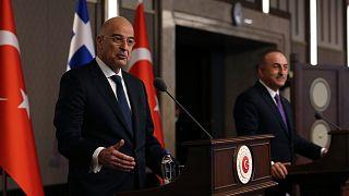 Greece's foreign minister Nikos Dendias, left, and his Turkish counterpart Mevlut Cavusoglu.