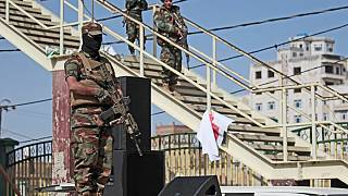 Houthi fighters stand guard during a rally marking six years for a Saudi-led coalition in Sanaa, Yemen