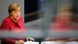 German Chancellor Angela Merkel delivers a speech in the Bundestag in Berlin, Germany, April 16, 2021.