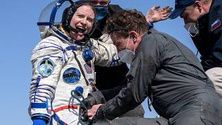 Expedition 64 NASA astronaut Kate Rubins is helped out of the Soyuz MS-17 spacecraft