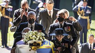 Pallbearers carry the coffin of Prince Philip, Duke of Edinburgh into St. George's Chapel at Windsor Castle, followed by members of his family