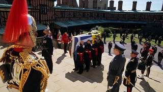 The coffin is held on the steps of St George's Chapel during the procession of Britain Prince Philip's funeral at Windsor Castle