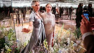 model Kate Moss, left, and her daughter Lila Grace Moss wear a creation for Fendi's Spring-Summer 2021 Haute Couture fashion collection presented in Paris on Jan. 27, 2021.