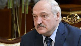 Belarusian President Alexander Lukashenko listens to Russian Prime Minister Mikhail Mishustin during their talks in Minsk, Belarus, April 16, 2021.