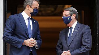 Greece's Prime Minister Kyriakos Mitsotakis, left, welcomes Cypriot President Nicos Anastasiades at Maximos Mansion in Athens,