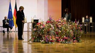 German President Frank-Walter Steinmeier, German Chancellor Angela Merkel attend a ceremony for Germany's victims of the coronavirus pandemic in Berlin.