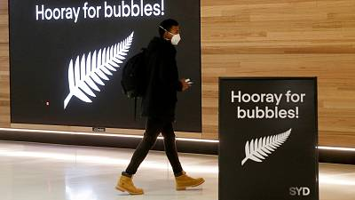 A passenger at Sydney Airport to catch a flight to New Zealand, Monday, April 19, 2021,