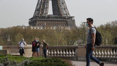 A man wearing a mask crosses the Bir Hakeim bridge in Paris, Thursday, April 1, 2021.
