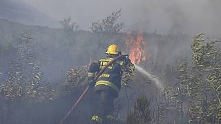 A fire rages on the slopes of Table Mountain, in Cape Town South Africa.