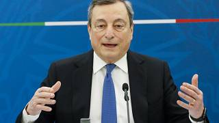 Italian Premier Mario Draghi addresses the media during a news conference, in Rome, April 16, 2021.